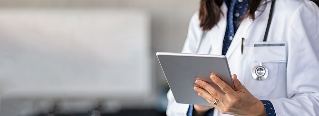female doctor holding digital tablet