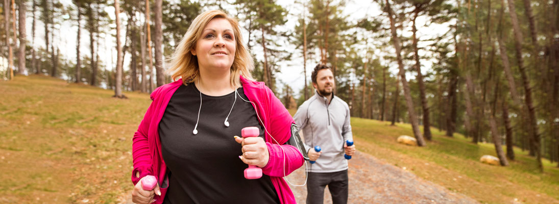 overweight woman running with man running behind her