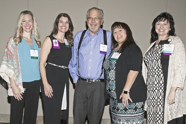 Butch Peters poses with four of the five nurse leaders who received the Alice A. Peters Nursing Leadership scholarships.
