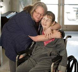 Caregiver and patient embracing