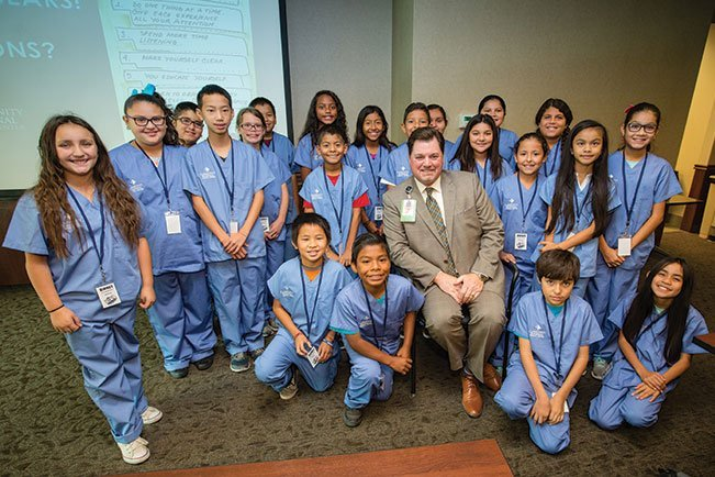 Craig Wagoner, CEO of Community Medical Centers' facilities, poses with some of the Birney Elementary students who participated in a hospital tour this past fall.