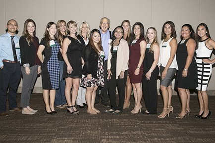 Butch Peters, President of the Leon S. Peters Foundation (standing center in the back row) is being honored by the nurse recipients of the Alice A. Peters Nursing Scholarship.